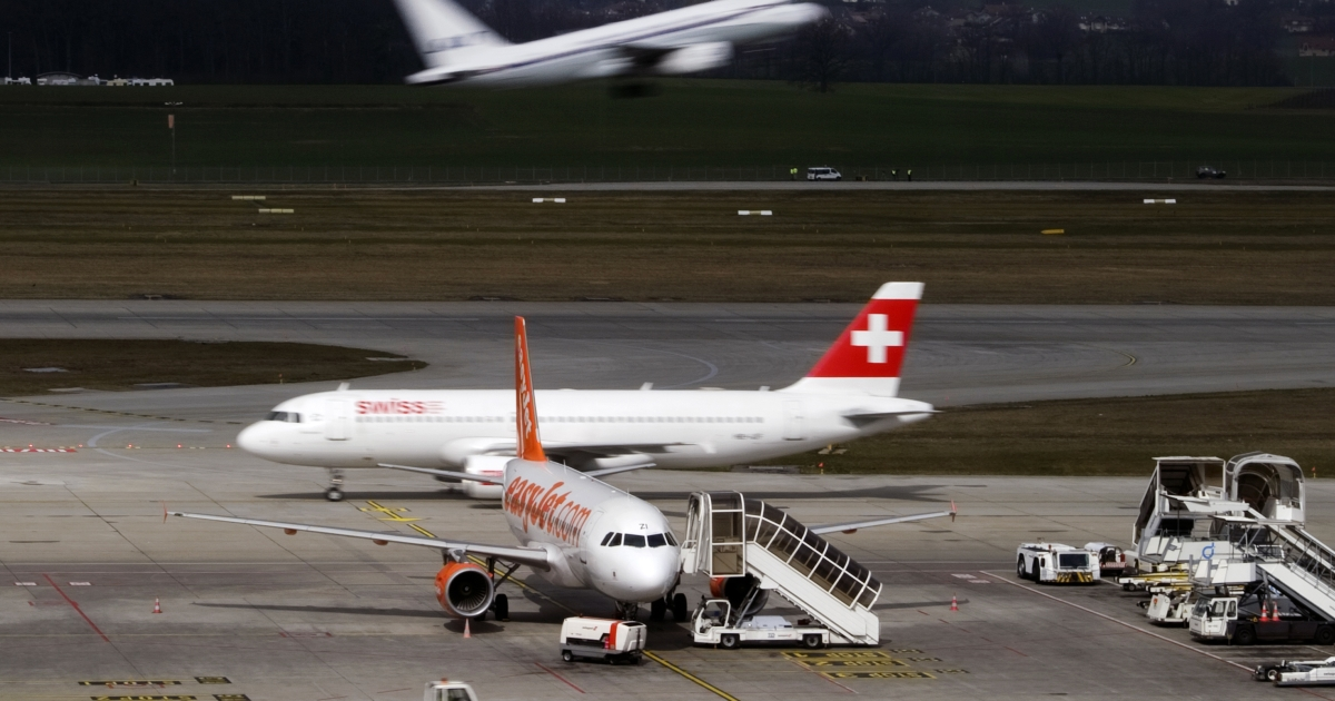 A Swiss International Airlines plane is seen on the tarmac at a Swiss airport on March 20, 2012.</p>