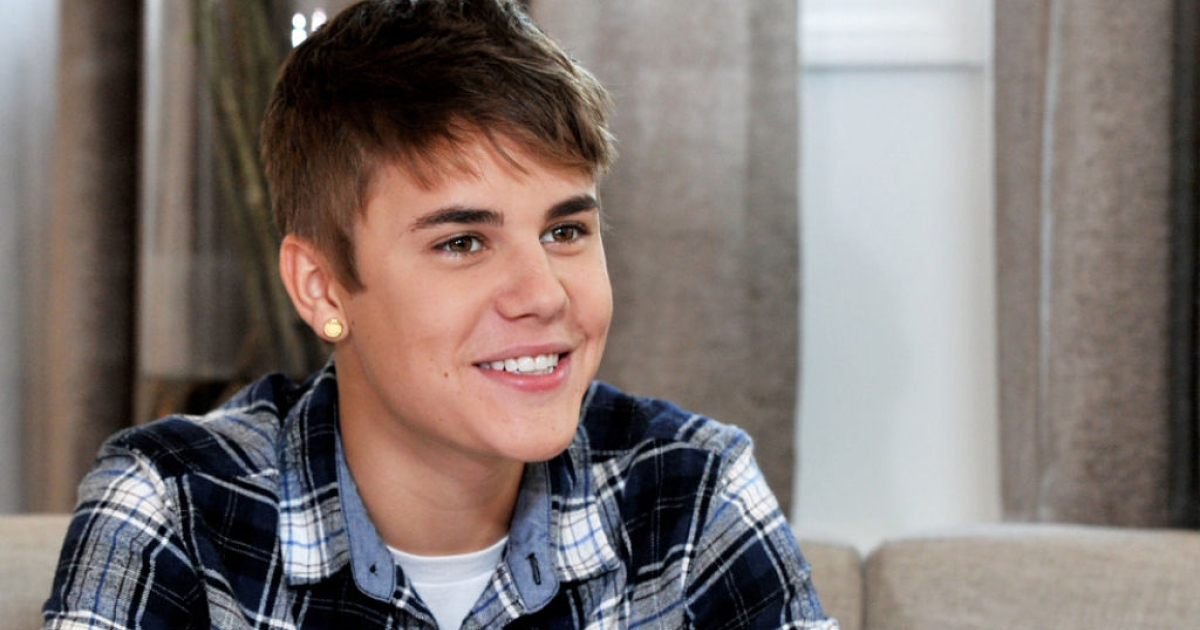 Musician Justin Bieber speaks an interview with Elvis Duran for