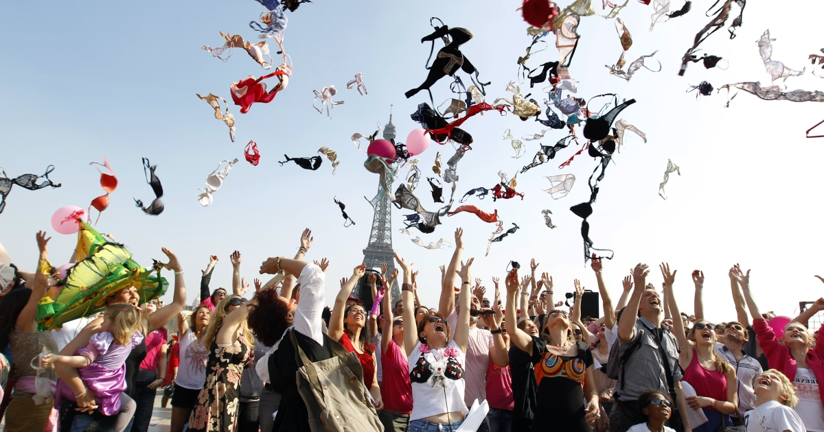 Women throw up their bras on the Parvis des droits de l'homme (Human rights Esplanade at the Trocadero) in Paris on March 25, 2012, as they take part in an event organized by