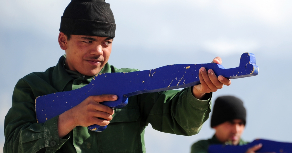 An Afghan National Police (ANP) trainee takes his aim with a mock gun at the PTC (Police Training Centre) shooting range of the German Police Project Team (GPPT) next to Camp Marmal, the Bundeswehr (German Federal Defence Force) base in Mazar-i-Sharif, on March 22, 2012.</p>