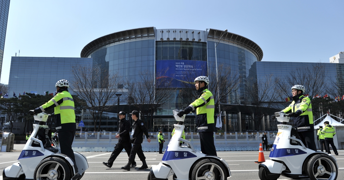 South Korean police patrol outside the venue where the 2012 Seoul Nuclear Security Summit will take place in Seoul on March 26, 2012.</p>