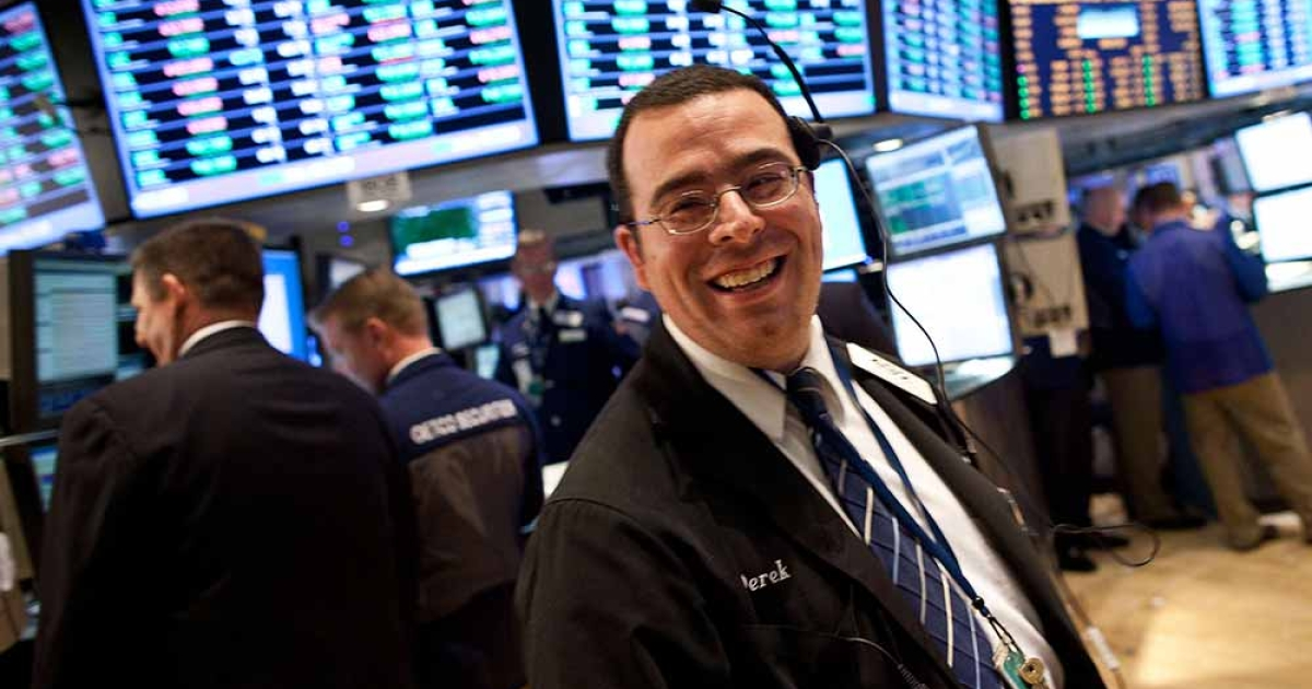 A trader works on the floor of the New York Stock Exchange on March 26, 2012 in New York City. The market soared to a 12-month high after comments made by Ben Bernanke regarding the economy.</p>