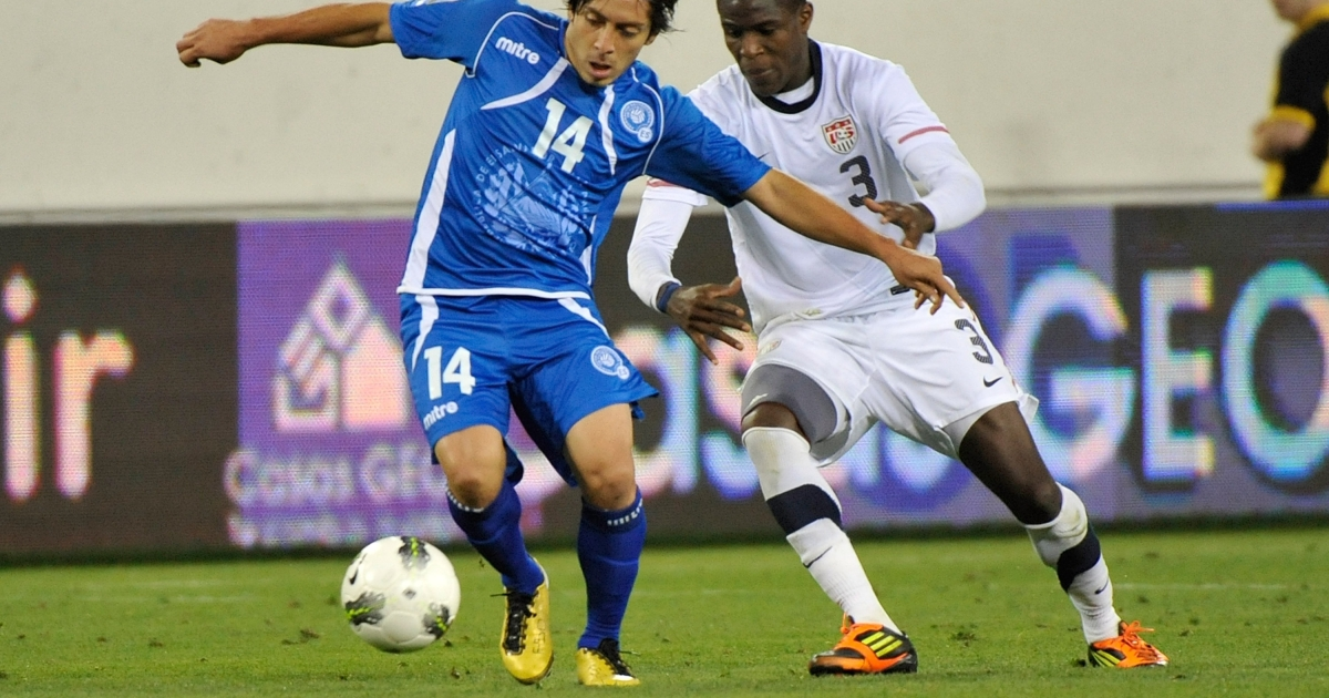 Herbert Sosa #14 of El Salvador and Kofi Sarkodie #3 of the USA chase a ball during a 2012 CONCACAF Men's Olympic Qualifying match at LP Field on March 26, 2012 in Nashville.</p>