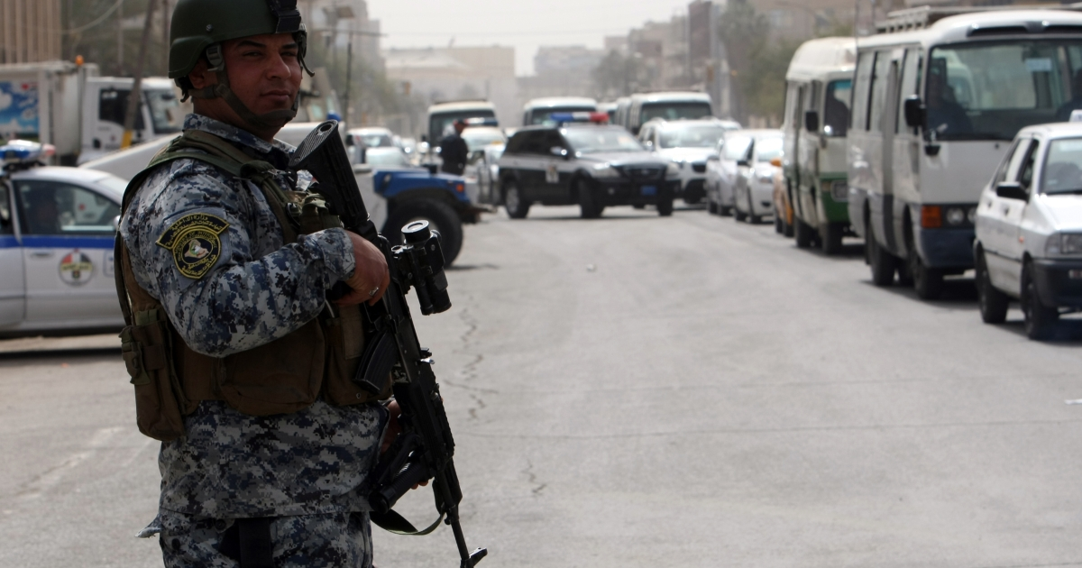 Iraqi security forces set up checkpoints on streets leading to the heavily fortified Green Zone in Baghdad on March 27, 2012.</p>