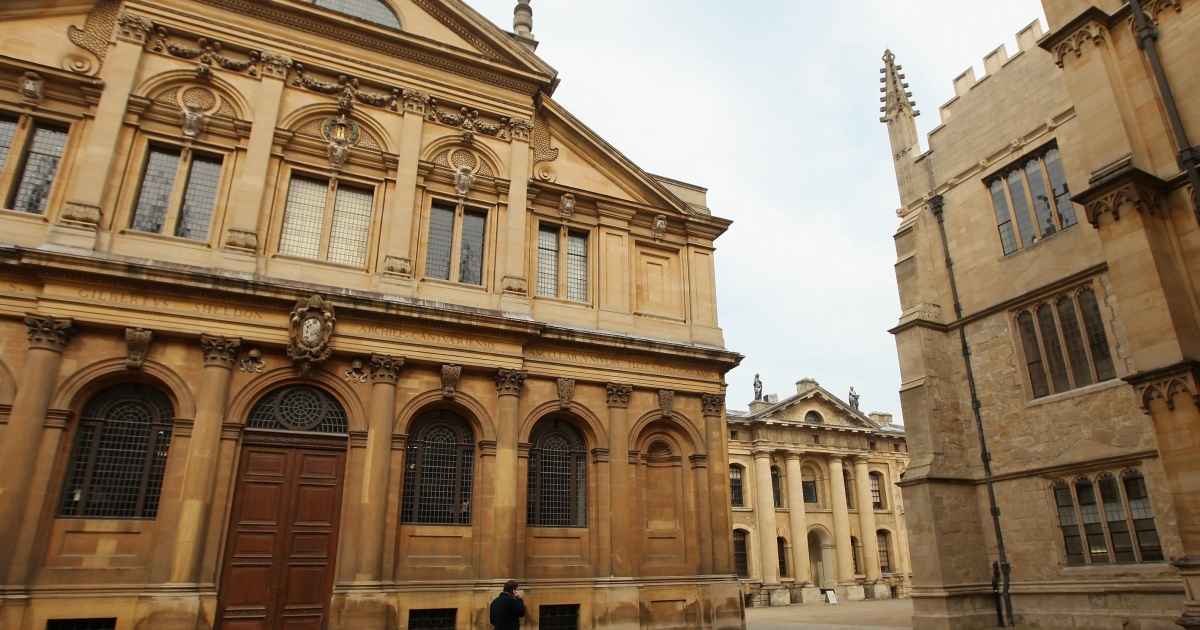 A man walks past the Bodleian Library's Clarendon Buildin on March 22, 2012 in Oxford, England.</p>