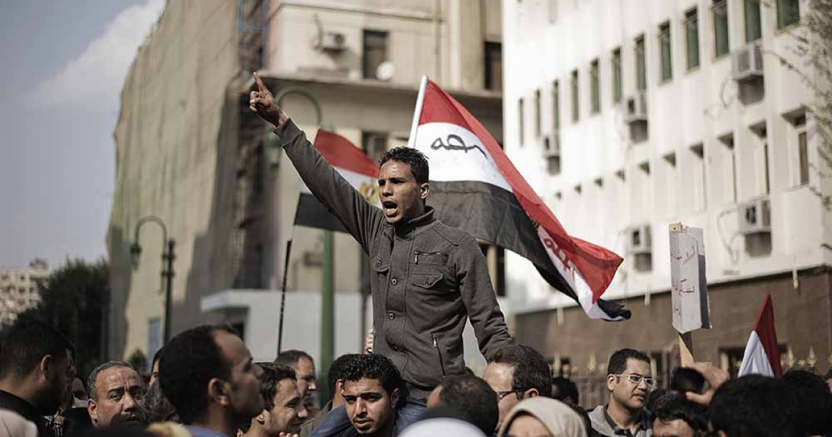 Hundreds of protesters demonstrate outside the Egyptian parliament building against the current Constitution Drafting Committee on March 28, 2012 in Cairo. Liberal and leftist parties have pulled out of a panel drafting Egypt's new constitution, they announced on March 27, accusing Islamists of monopolizing the process that will deliver the country's post-revolution charter.</p>