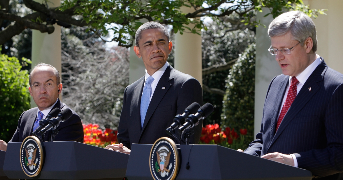 Canadian Prime Minister Stephen Harper speaks next to US President Barack Obama and Mexican President Felipe Calderon during a joint news conference in the Rose Garden of the White House in Washington, DC following the North American Leaders Summit (NALS) on April 2, 2012.</p>