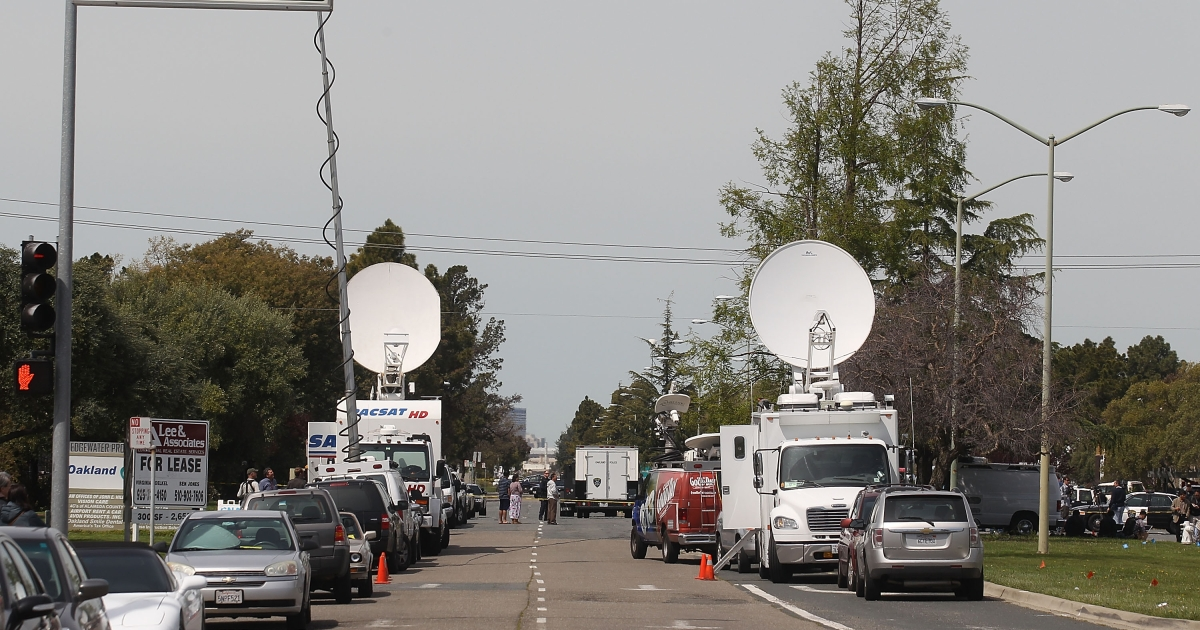 News media congregate at the scene at Oikos University after a shooting that killed multiple people on April 2, 2012 in Oakland, California.</p>