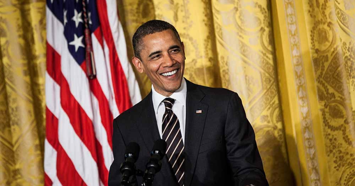 US President Barack Obama smiles while speaking during a prayer breakfast in the East Room of the White House April 4, 2012 in Washington, DC.</p>