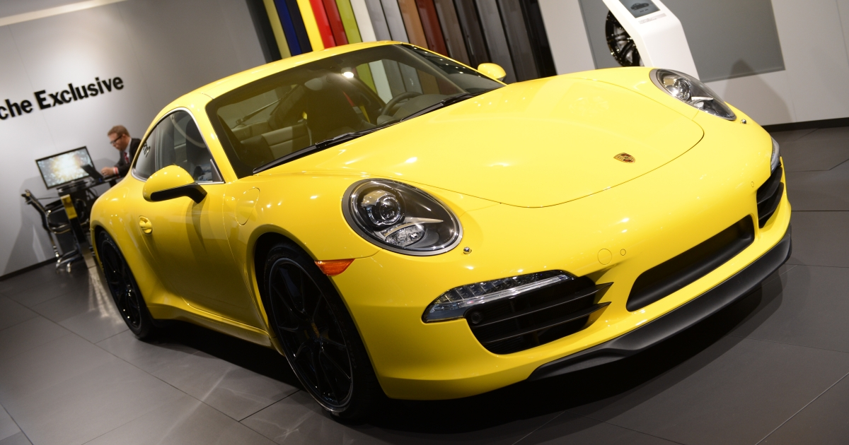 The Porsche 911, declared the 2012 Performance Car of the Year, in on display during the second day of press previews at the New York International Automobile Show on April 5, 2012 in New York.</p>