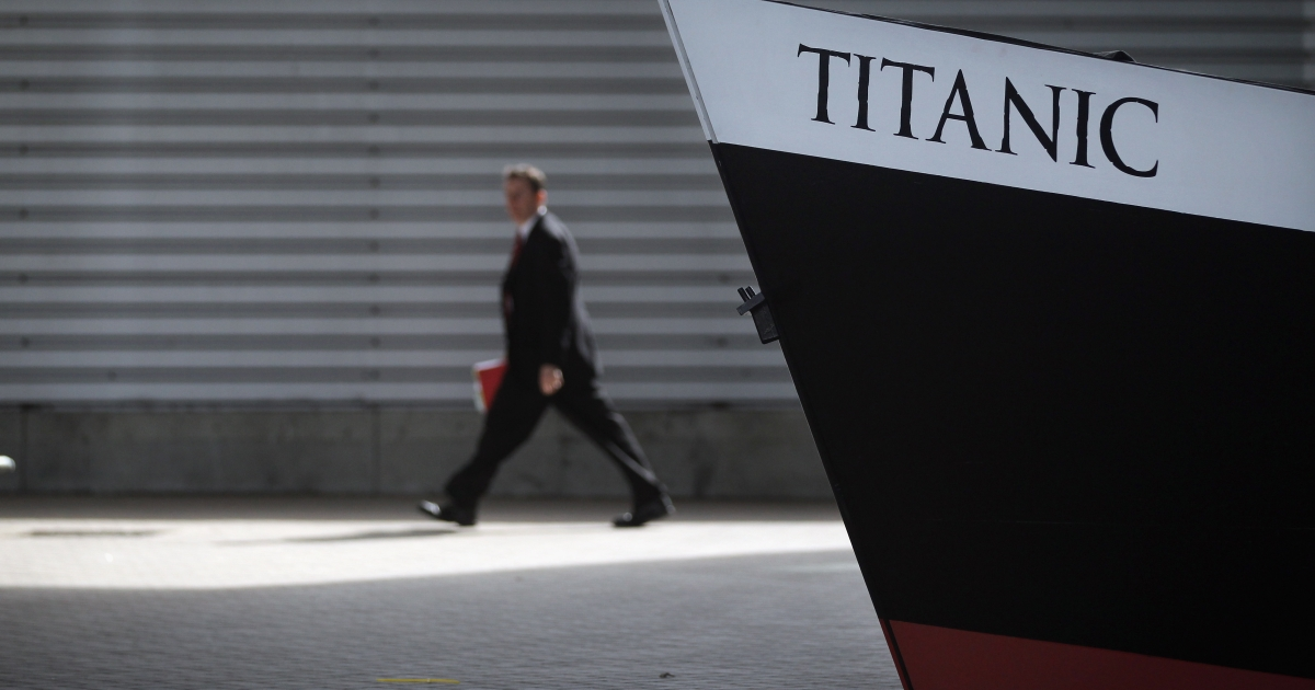 A guest walks past a replica bow of RMS Titanic beside birth 43 and 44 at Southampton Dock during a Titanic Centenary Memorial on April 10, 2012 in Southampton, England. The births mark the departure point of RMS Titanic when it set sail one hundred years earlier.</p>