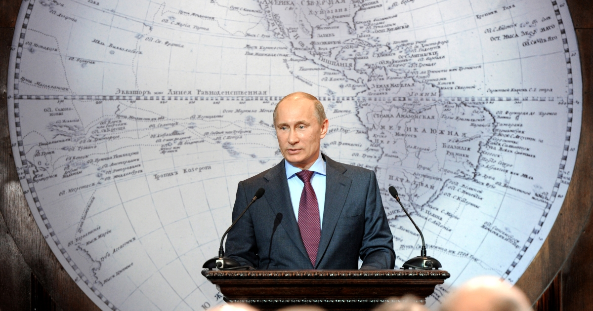 Russia's Prime Minister and President-elect Vladimir Putin (C) speaks in the Russian Geographical Society in St. Petersburg, on April 10, 2012.</p>