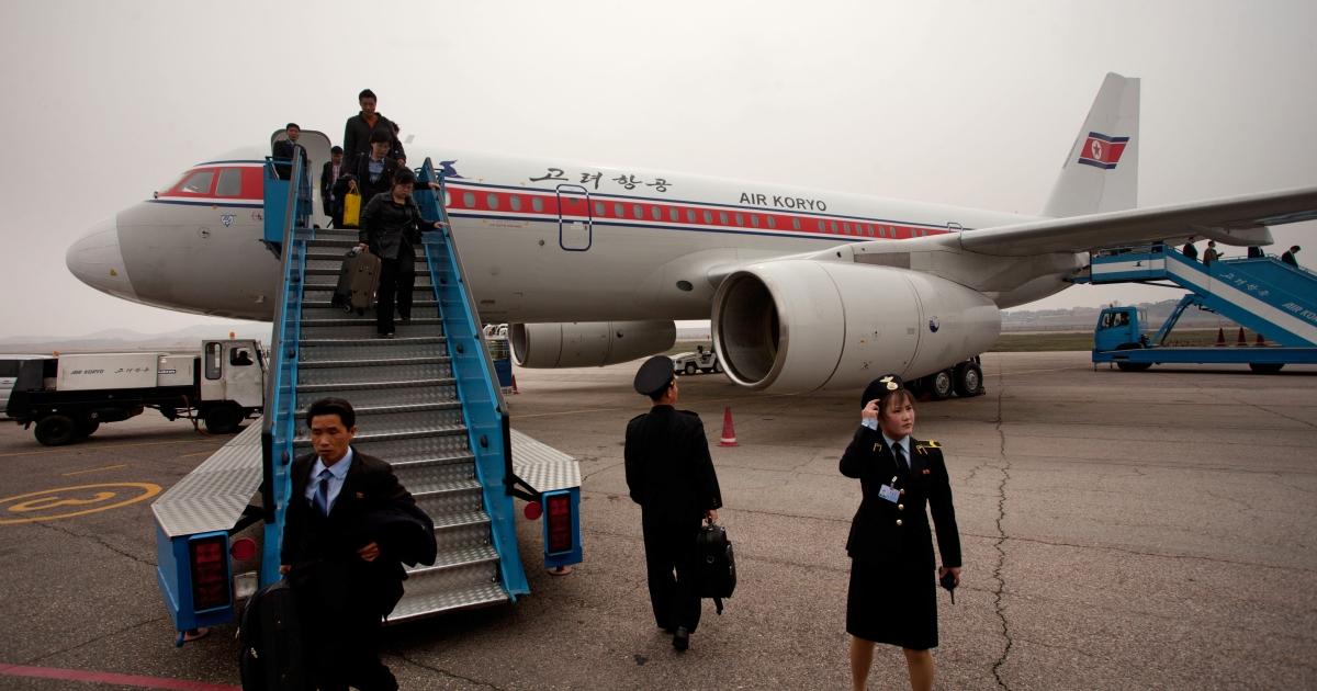 Travellers disembark from an Air Koryo Topolev 504 aircraft upon arrival at Pyongyang airport on April 12, 2012.</p>