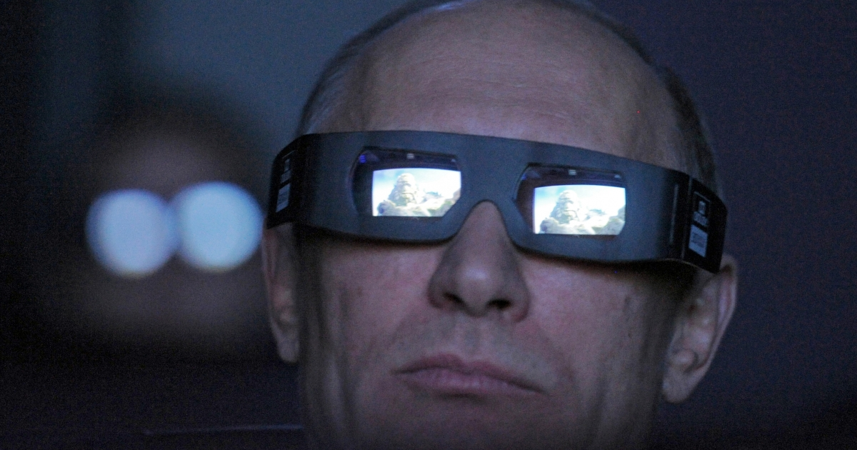 Russia's Prime Minister Vladimir Putin looks on through 3D glasses during his visit to Moscow's Planetarium, on April 12, 2012.</p>