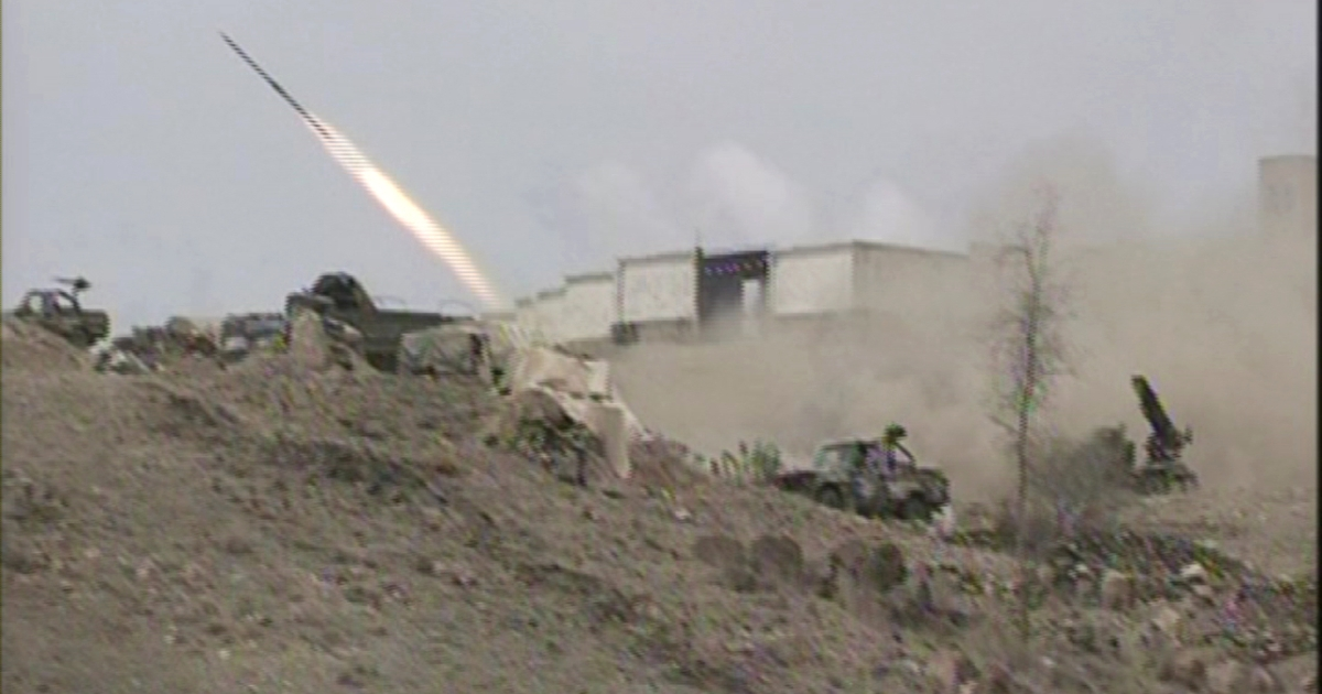 An image taken with a mobile phone shows a Yemeni army vehicle firing a rocket during fighting between army forces and militant supporters of the al-Qaeda in the south Yemen town of Loder, on April 14, 2012.</p>