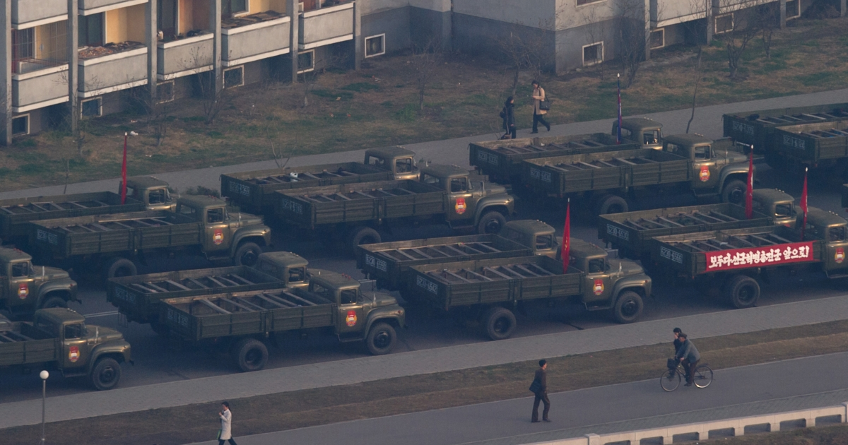 Trucks line up on a street in Pyongyang prior to celebrations in memory of North Korea's first leader Kim Il Sung early on April 15, 2012.</p>
