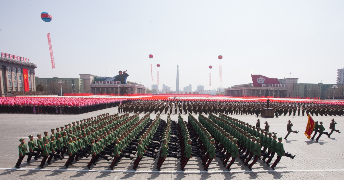 North Korean soldiers march during a military parade in honour of the 100th birthday of the late North Korean leader Kim Il-Sung in Pyongyang on April 15, 2012.</p>
