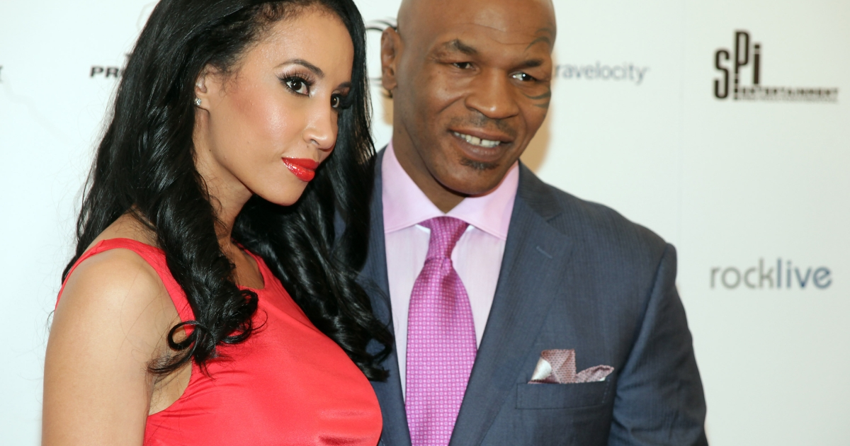 US fighting legend Mike Tyson (R) poses with his wife Kiki on the red carpet before the start of Tyson's one-man show called 'Mike Tyson: Undisputed Truth, Live on Stage', in the Hollywood Theatre at the MGM Grand Hotel in Las Vegas, Nevada on April 14, 2012.</p>