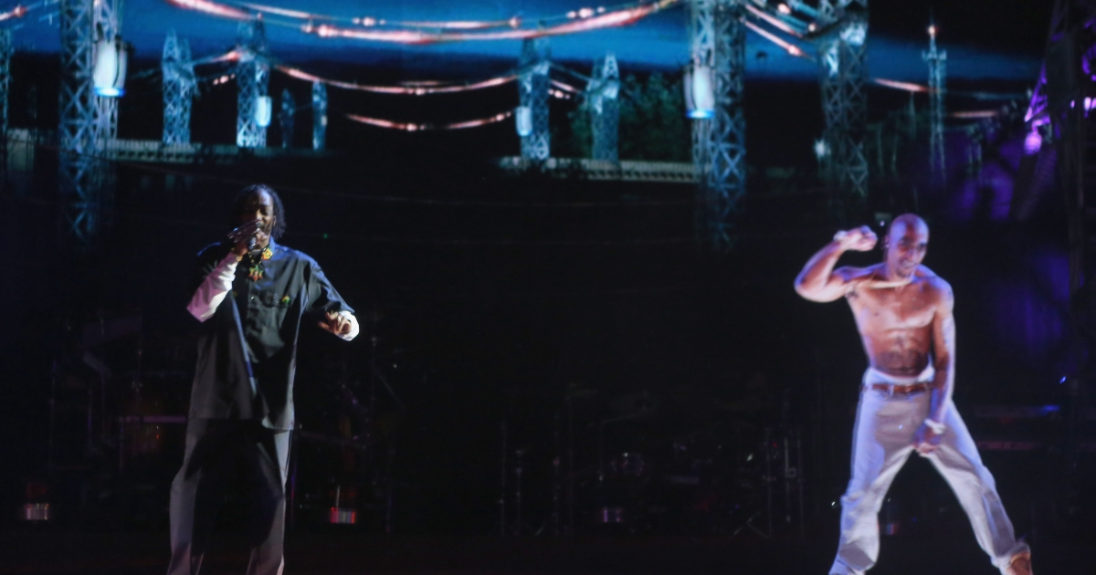Rapper Snoop Dogg (L) and a hologram of deceased rapper Tupac Shakur perform onstage during day 3 of the 2012 Coachella Valley Music &amp; Arts Festival at the Empire Polo Field on April 15, 2012 in Indio, California.</p>