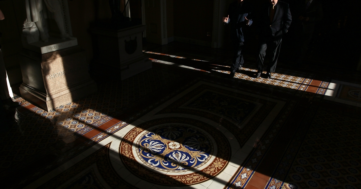 Senate Minority Leader Mitch McConnell walks with Sen. Roy Blount to a vote on the Senate floor April 16, 2012 in Washington, DC. The senators were walking to a cloture vote on the 'Buffett Rule' before the U.S. Senate.</p>