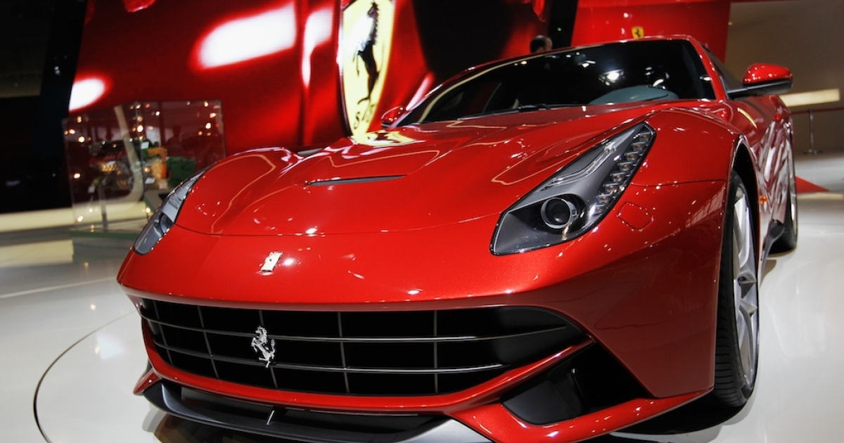 A Ferrari F12 berlinetta car is displayed during the media day of the 2012 Beijing International Automotive Exhibition at Beijng International Exhibition Center.</p>