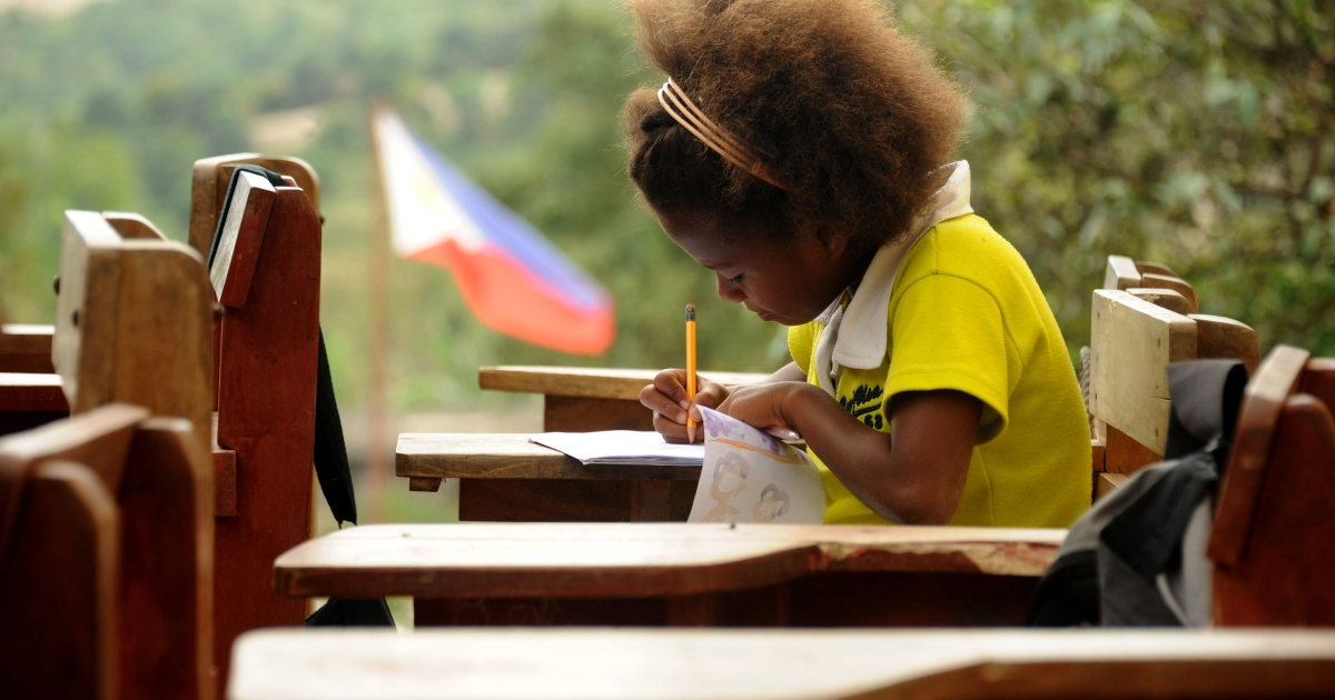 An Ayta elementary student works on her assignment on a roofless classroom at an elementary School at Porac, Pampanga, north of Manila. Spoken by just 3,000 people in the hills northwest of Manila, Ayta Magindi is one of several dozen of endangered languages in the Philippines.</p>