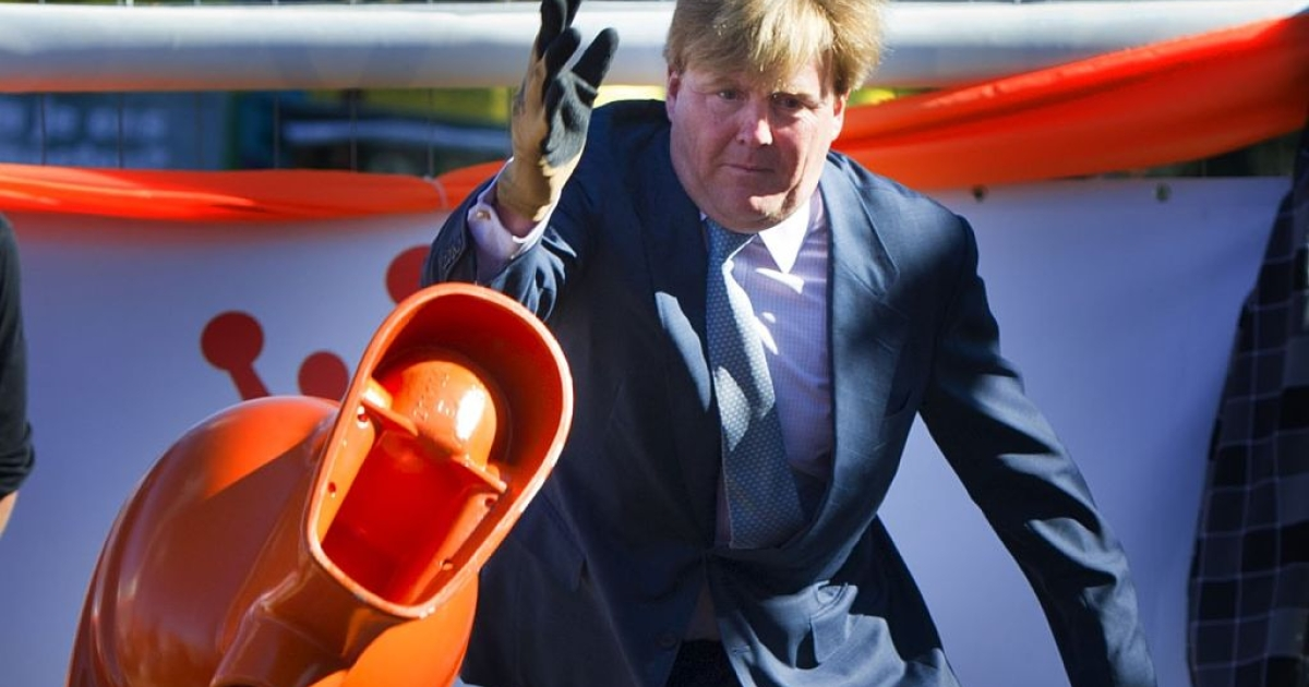 Prince Willem-Alexander of the Netherlands participates in a toilet throwing event during Queen's Day festivities in Rhenen on April 30, 2012.</p>