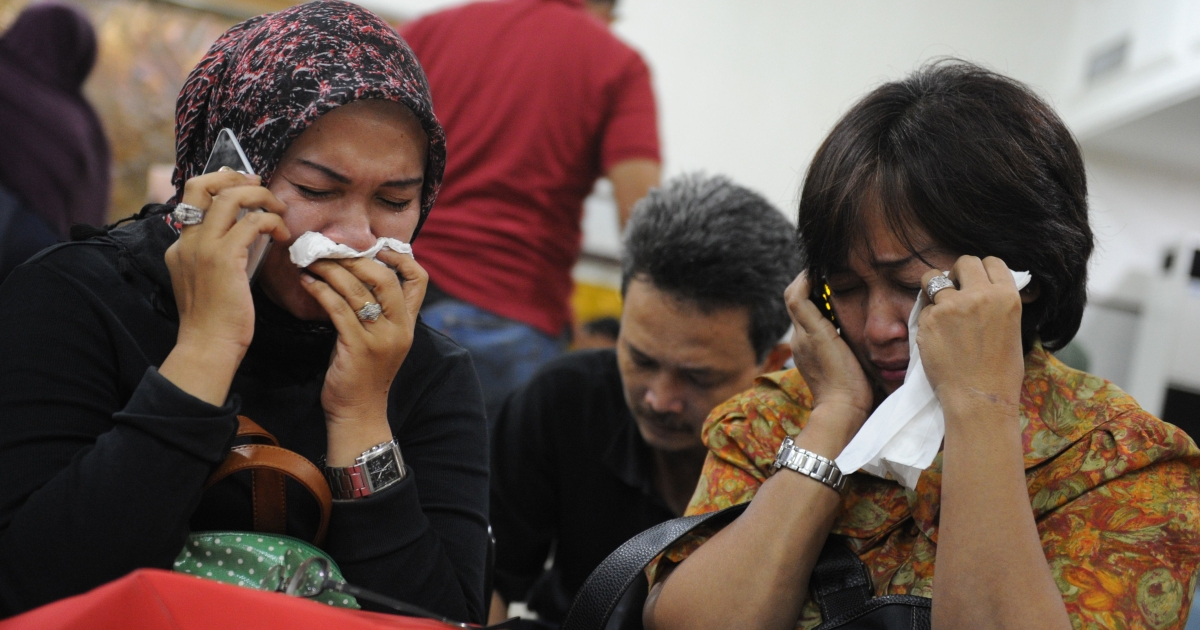 Indonesian relatives of passengers of the Russian Sukhoi Superjet 100 cry at Halim Perdanakusuma airport in Jakarta on May 10, 2012 as rescuers search for survivors at crash site in Mount Salak in Western Java province.</p>