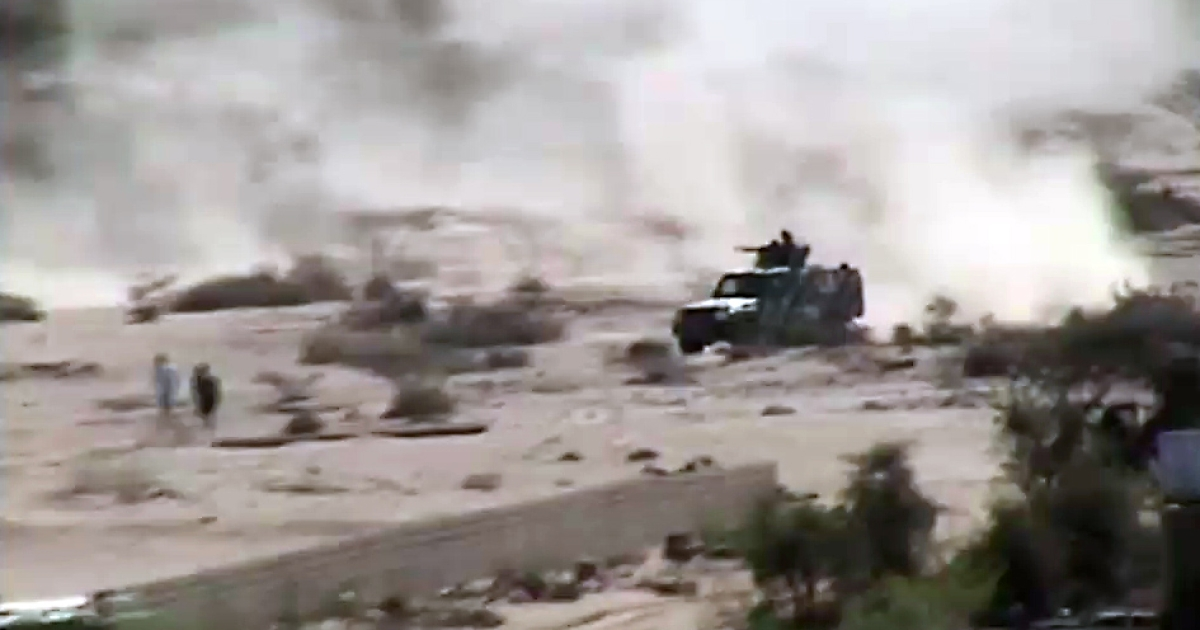 An image taken with a mobile phone allegedly shows an armed vehicle driving in Loder, in the restive southern Abyan province, as clashes continued between Al Qaeda militants and the Yemeni army forces on May 16, 2012.</p>