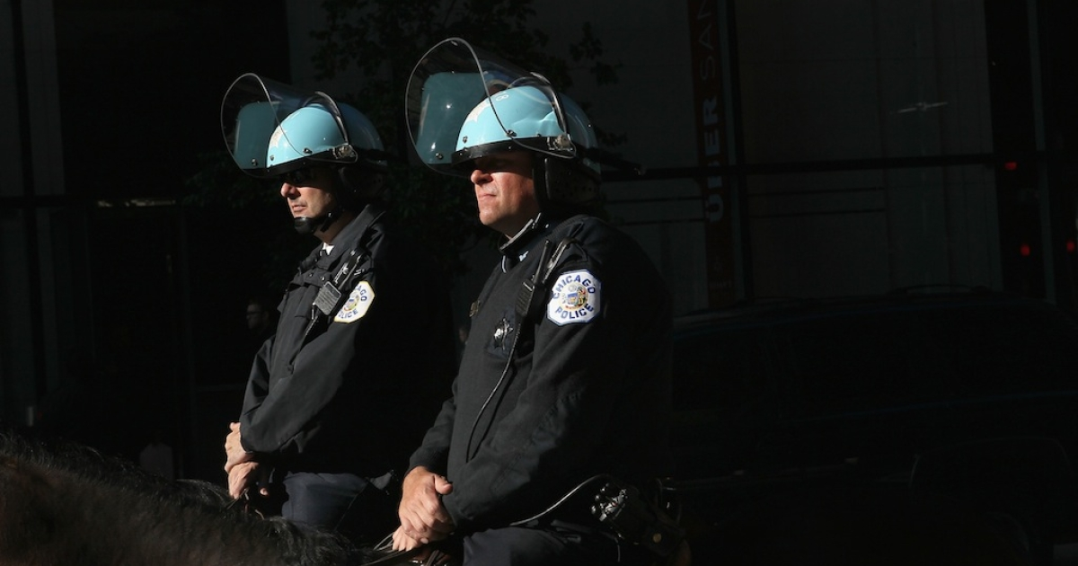 Chicago mounted police officers watch over a protest taking place in the Federal Building Plaza May 16, 2012 in Chicago, Illinois. It was the third straight day of protests in what is expected to be a full week of demonstrations as Chicago prepares to host the NATO Summit May 20-21</p>