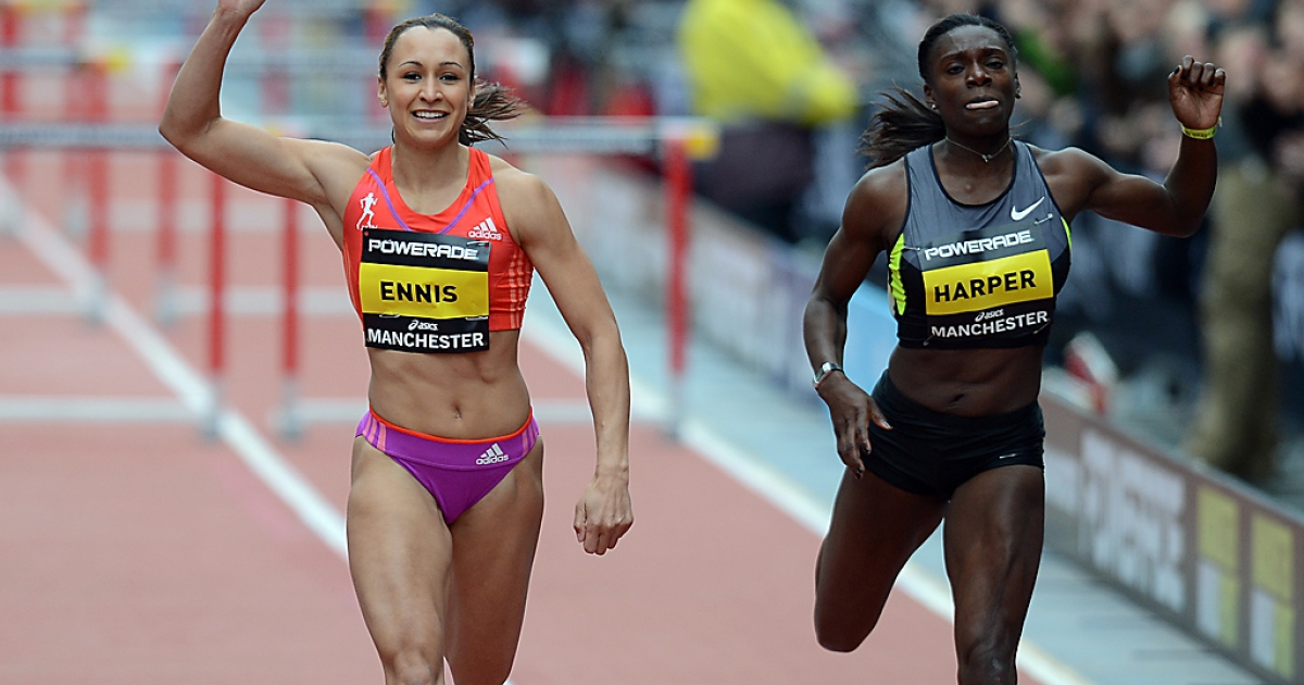 Jessica Ennis of Britain celebrates after beating Dawn Harper of the US during the women's 100-meter hurdles during the Great City Games in Manchester, England, on May 20, 2012.</p>