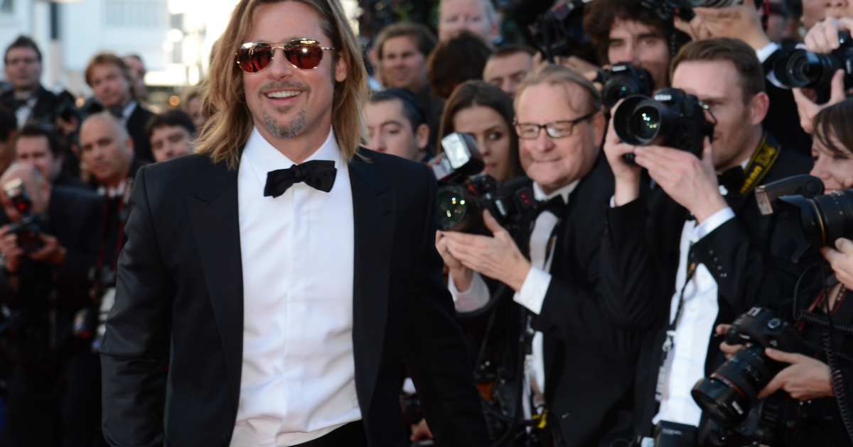 US actor Brad Pitt arrives for the screening of 'Killing them Softly' presented in competition at the 65th Cannes film festival on May 22, 2012 in Cannes.</p>