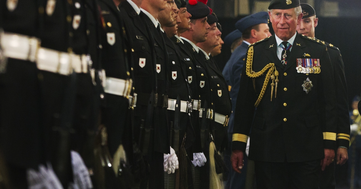 Britain's Prince Charles inspects the Guard of Honour at the Fort York Armoury for the 1812 Commemorative Military Muster in Toronto, May 22, 2012.</p>