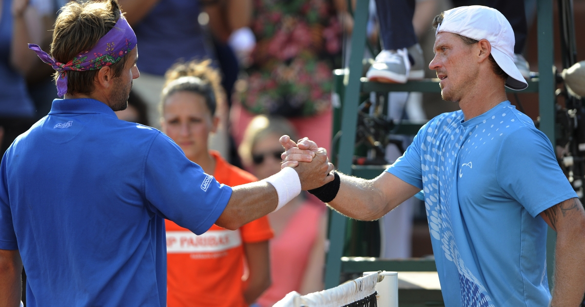 France's Arnaud Clement (L) shakes hands with Russia's Alex Bogomolov Jr at the end of their men's Singles 1st Round tennis match of the French Open tennis tournament May 28, 2012.</p>