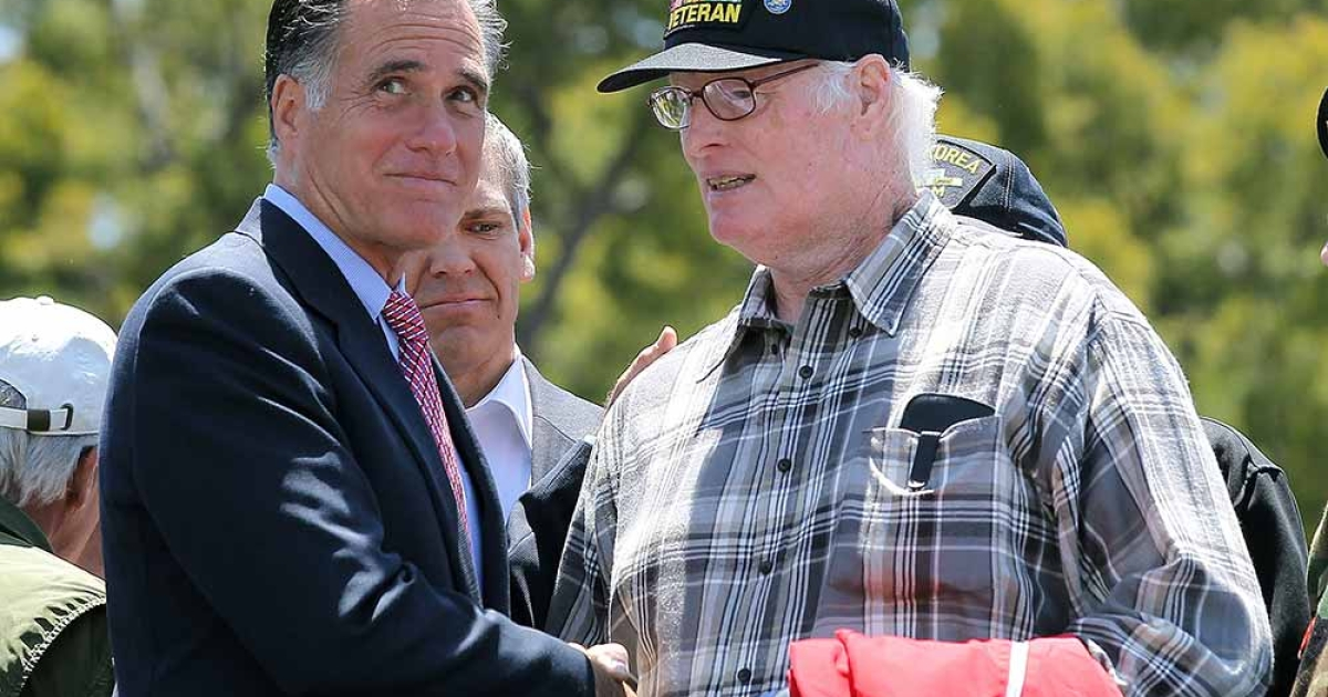 Republican presidential candidate, former Massachusetts Gov. Mitt Romney (L) greets a veteran during a Memorial Day Tribute at Veterans Museum &amp; Memorial Center on May 28, 2012 in San Diego, California. U.S. Sen John McCain (R-AZ) joined Mitt Romney at a Memorial Day tribute before heading to Colorado.</p>