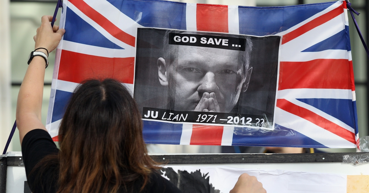 Supporters of Wikileaks founder Julian Assange demonstrate outside the UK Supreme Court prior to Mr Assange's extradition appeal on May 30, 2012 in London, England.</p>