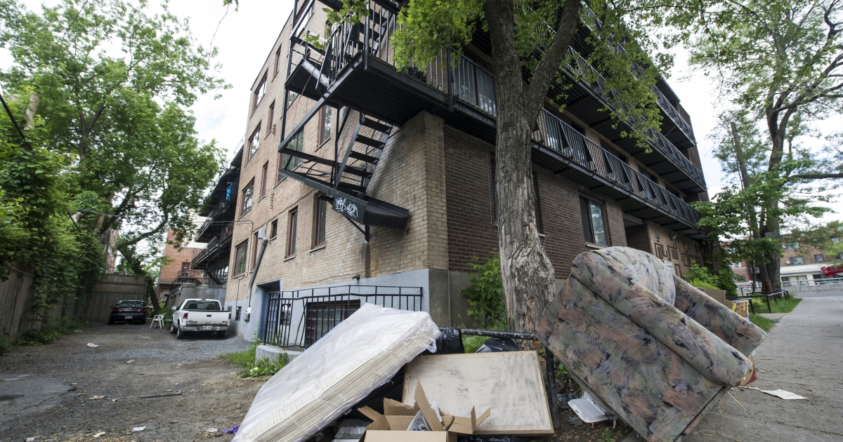 A mattress and sofa reportedly taken out of the apartment of Luka Magnotta lie just outside an apartment building in Montreal on May 31, 2012.</p>