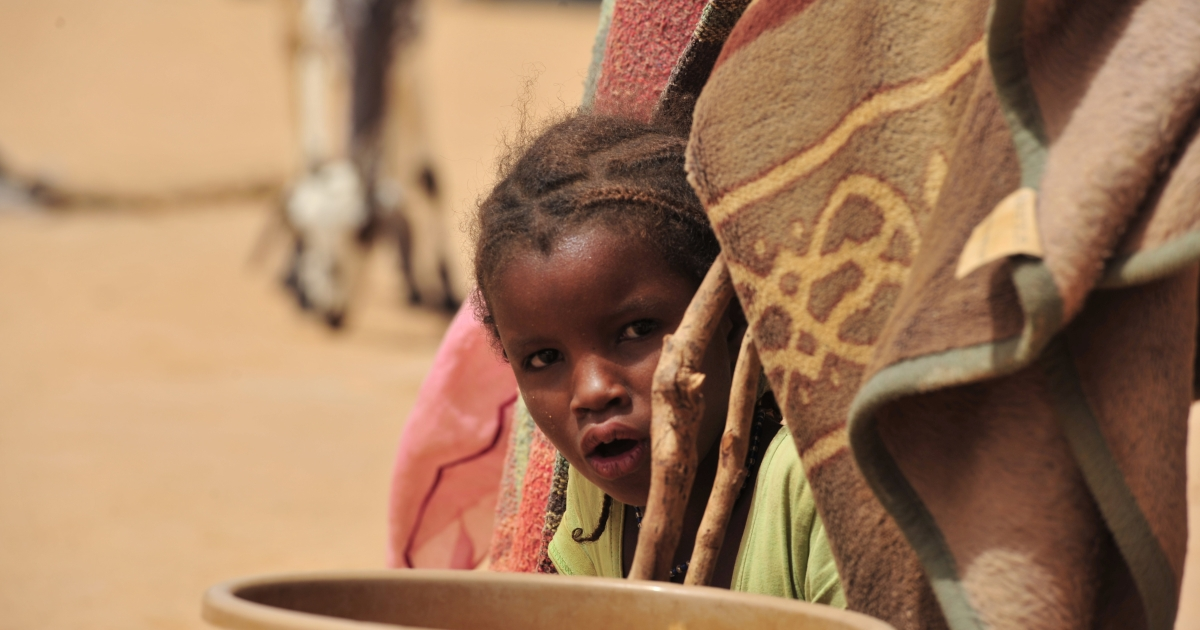 A young refugee from northern Mali looks out from her tent inside the UNHCR Mangaize refugee camp, 100 miles north of Niamey, on June 2, 2012.</p>