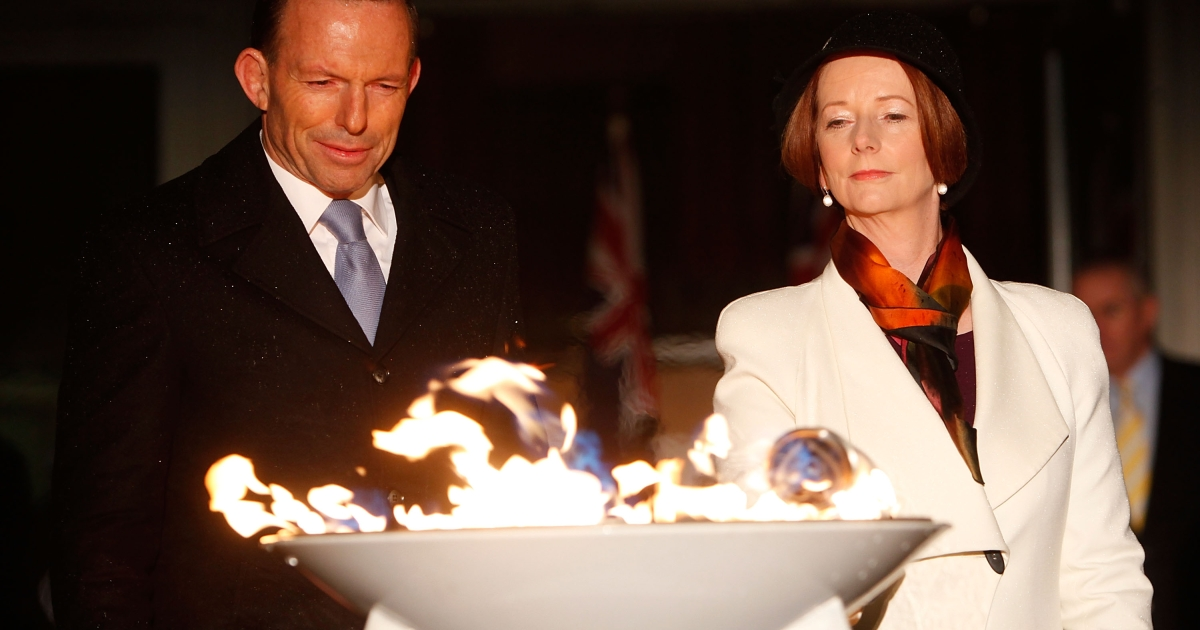 The Prime Minister of Australia, Julia Gillard and the Opposition Leader, Tony Abbott jointly light a ceremonial beacon to mark the Queens Diamond Jubilee at Parliament House on June 4, 2012 in Canberra, Australia.</p>