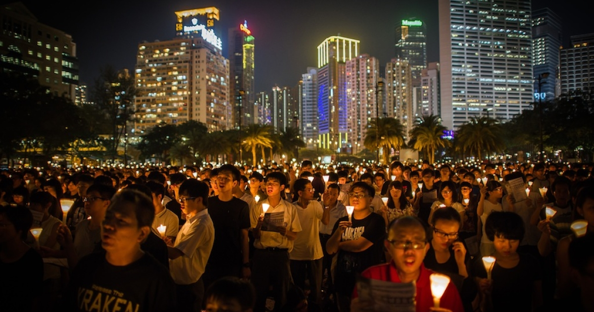 People take part in a a candlelight vigil in Hong Kong on June 4, 2012 held to mark the crackdown on the pro-democracy movement in Beijing's Tiananmen Square in 1989. Hundreds, perhaps thousands, are believed to have died when the government sent in tanks and soldiers to clear Tiananmen Square, bringing a violent end to six weeks of pro-democracy protests.</p>