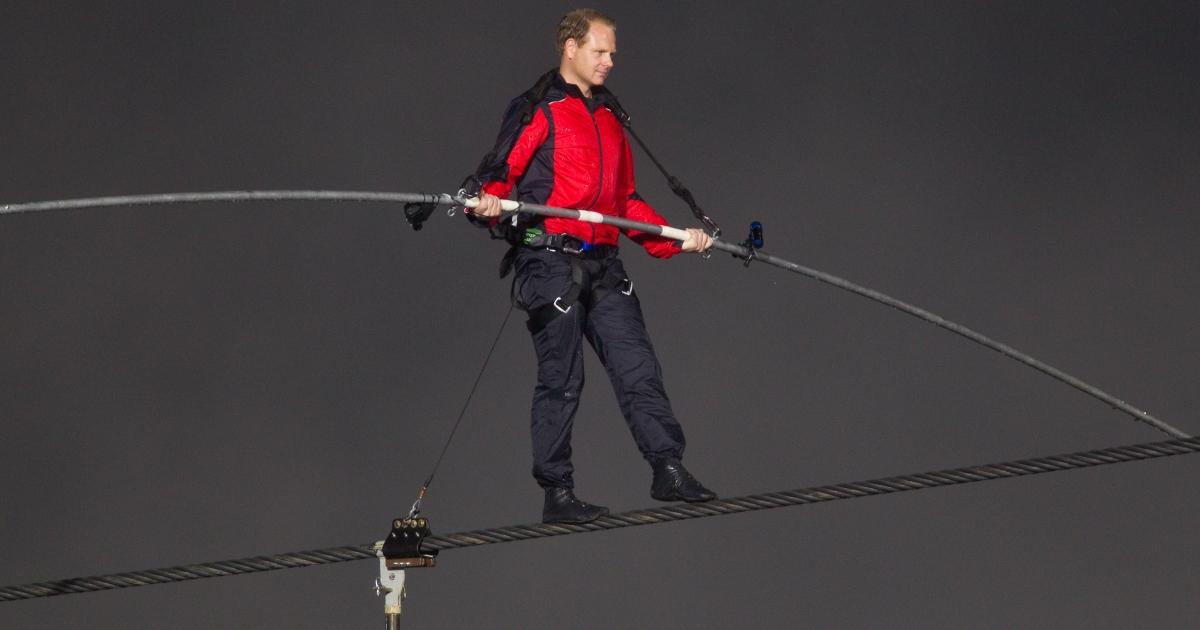 Tightrope walker, Nik Wallenda crosses Niagara Falls on a wire, June 15, 2012.</p>