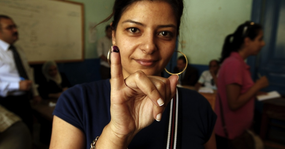 An Egyptian woman shows her ink-stained finger after casting her vote at a polling station in Cairo on June 16, 2012. When it comes to women's rights, religion isn't the decisive factor many once thought it was. Instead, new polling shows the economy is more to blame.</p>