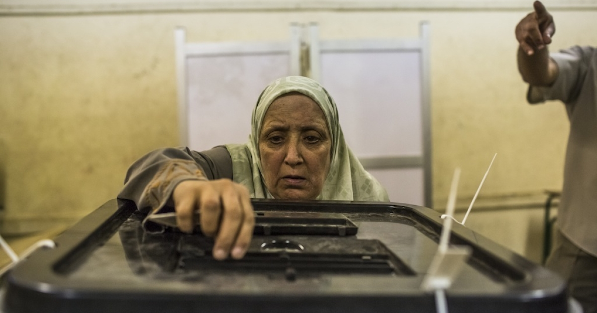 An Egyptian woman casts her vote at a polling station on June 16, 2012 in Cairo, Egypt. Egyptians went to the polls after Egypt's Supreme Constitutional Court on Thursday ruled that the Islamist-led Parliament must be immediately dissolved. Some are calling these actions a