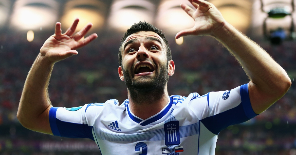 Giorgos Tzavelas of Greece celebrates victory and progress to the quarter finals during the UEFA Euro 2012 group A match between Greece and Russia at The National Stadium on June 16, 2012 in Warsaw, Poland.</p>