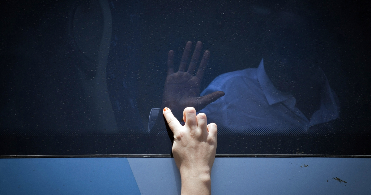 Two girls divided by the bus window, touch hands as South Sudanese refugees board a bus taking them to Ben Gurion International airport, near Tel Aviv.</p>