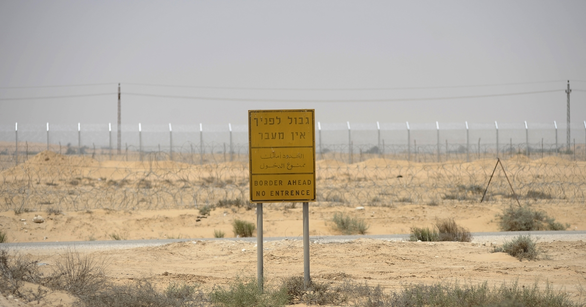 An Israeli sign is seen on the border with Egypt near the Israeli village of Beer Milka on June 18, 2012.</p>