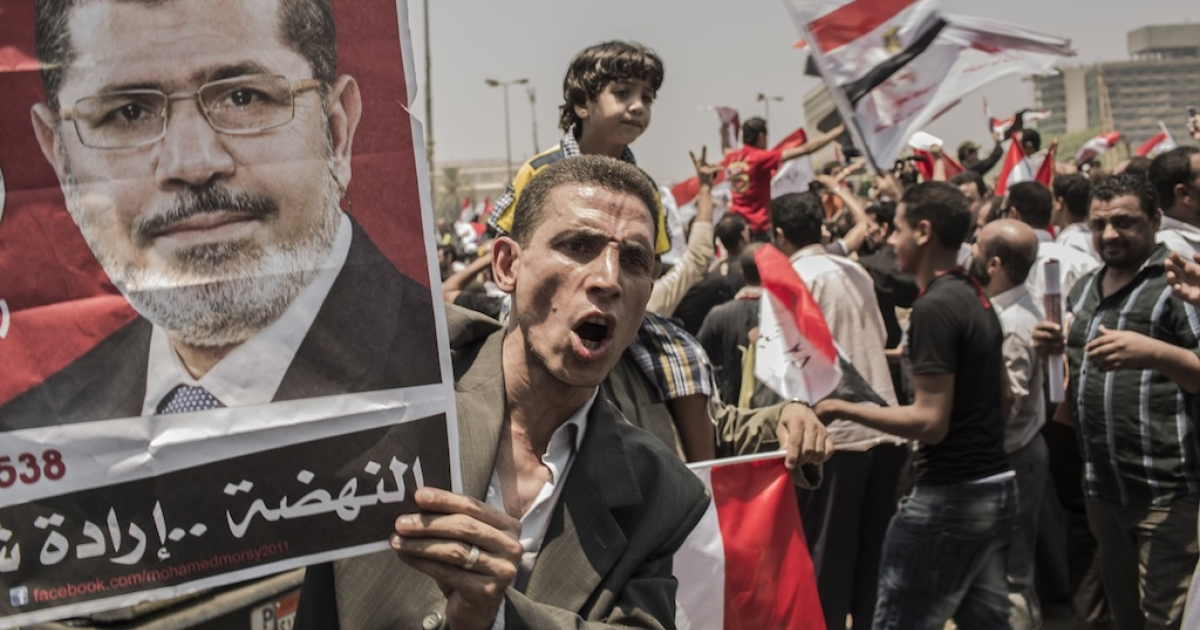 CAIRO, EGYPT - JUNE 18: Egyptians supporters celebrate a premature victory for their presidential candidate Mohamed Morsi, in Tahrir Square on June 18, 2012 in Cairo, Egypt.</p>