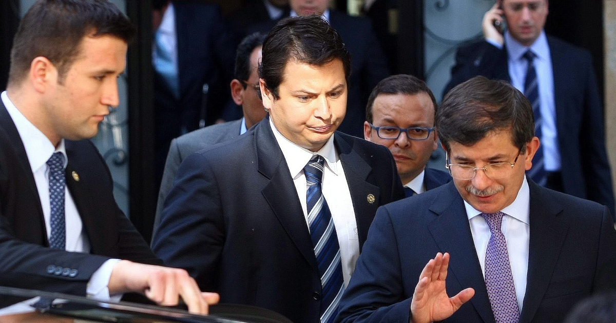 Turkey's Foreign Minister Ahmet Davutoglu (R) leaves a meeting focused on Syria with army generals and other officials on Syria, in Ankara, on June 23, 2012.</p>
