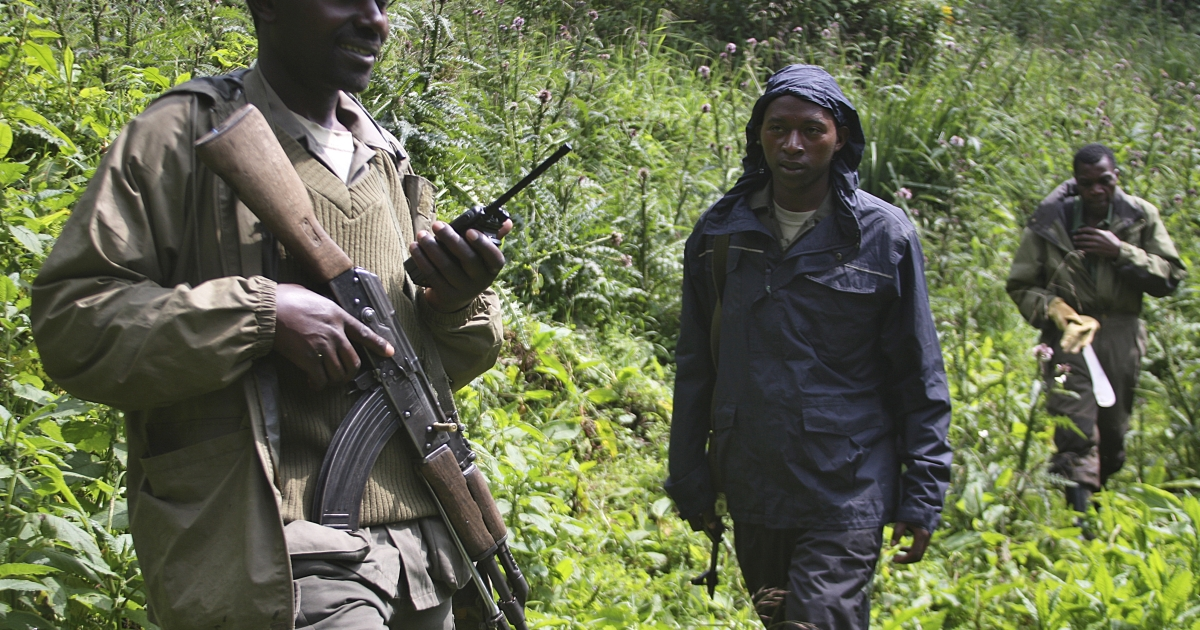 This photo take on June 17, 2012, shows armed rangers patrolling in the Virunga mountains, shared by Rwanda, Uganda and Democratic Republic of Congo.</p>