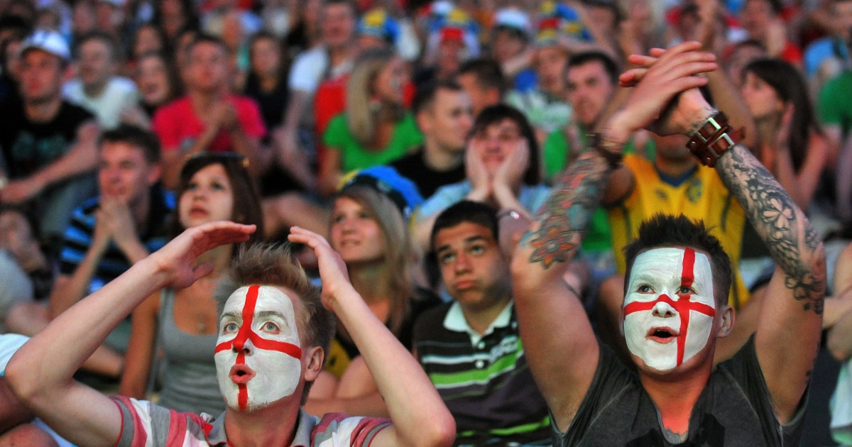 England's fans react as they watch the quarter- final match England vs Italy on giant screen in Kiev on June 24, 2012. One Chinese fan died while watching every single match in the Euro 2012.</p>
